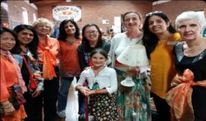 A group of people at a local hall fundraising