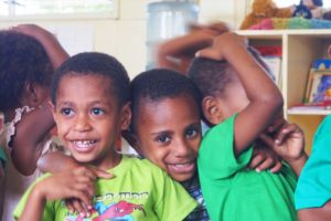 Three young boys at school in Papua New Guinea