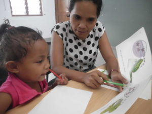 Parent and child learning with pen and book