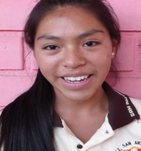 Young female peruvian student looking at camera